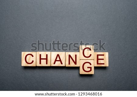 Wooden cube with word change to chance on wood table. Personal development and career growth or change yourself concept. concept of motivation, goal achievement, potential, incentive, overcoming