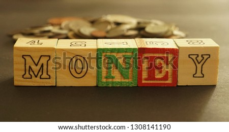 Wooden cubes forming the word Money. Word Money written using wooden cubes #1308141190