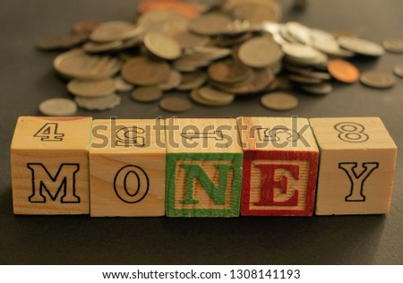Wooden cubes forming the word Money. Word Money written using wooden cubes #1308141193