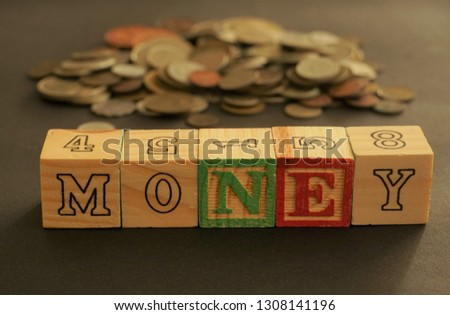 Wooden cubes forming the word Money. Word Money written using wooden cubes #1308141196