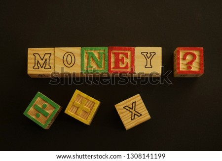 Wooden cubes forming the word Money. Word Money written using wooden cubes #1308141199