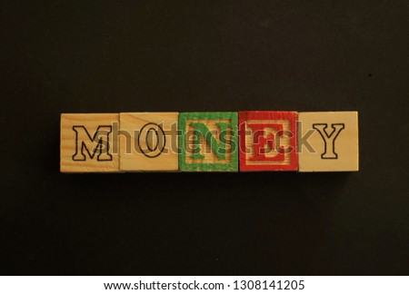 Wooden cubes forming the word Money. Word Money written using wooden cubes #1308141205