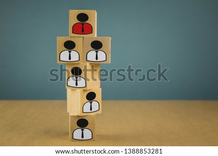 wooden cubes in the form of bosses and subordinates, personnel subordination on a blue background #1388853281