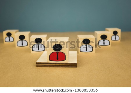 wooden cubes in the form of bosses and subordinates, personnel subordination on a blue background #1388853356