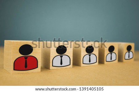 wooden cubes in the form of bosses and subordinates, personnel subordination on a blue background #1391405105