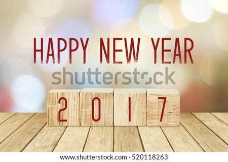 Wooden cubes with 2017 and happy new year over blur bokeh background, new year banner