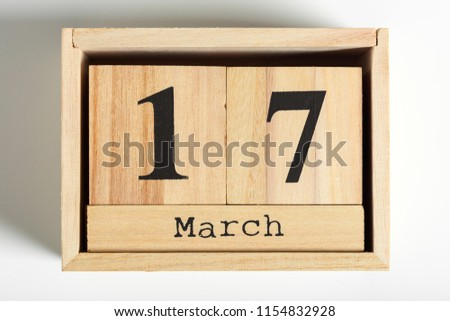 Wooden cubes with date on white background. 17th of March