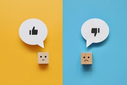 Wooden cubes with the image of like and dislike. Choose between like and dislike