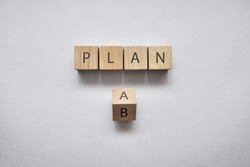 Wooden cubes with the word plan and option A and B. Choose between two options for action in life