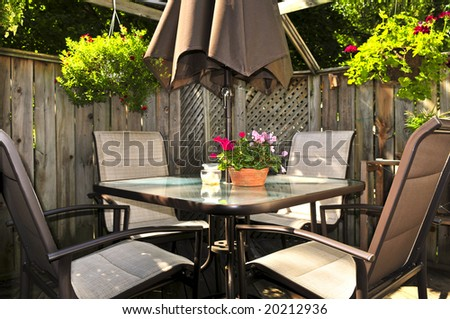 Wooden deck of a house with patio furniture