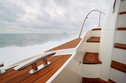 Wooden deck of yacht in motion