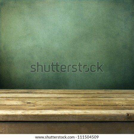 Wooden deck table on green grunge background #111504509