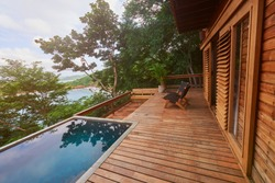 Wooden deck with pool on natural background