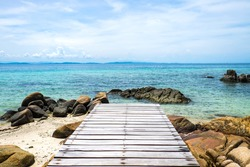 Wooden deck, wooden bridge , Tropical beach in Munnork island, Rayong, Thailand