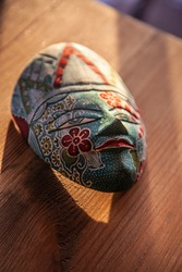 Wooden Decorated Traditional Asian Face Mask from Top with Light and Shadow