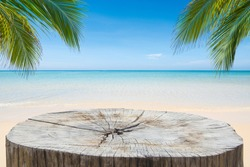 Wooden desk or stump on sand beach in summer. background. For product display,Clipping Path.