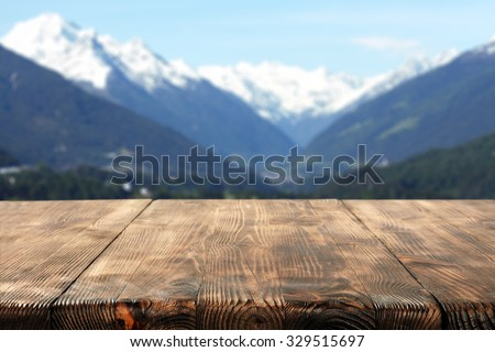wooden desk space and mountains