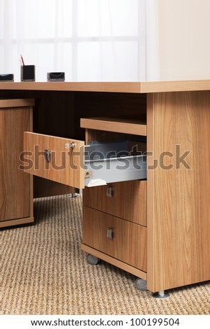 wooden desk with an open box in the office