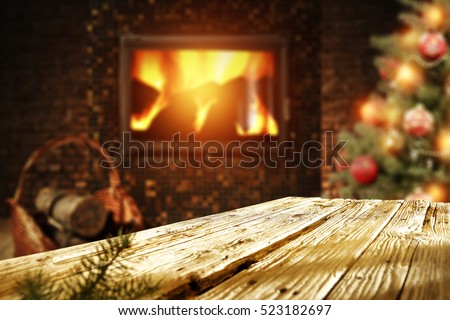 wooden desk xmas tree and fireplace with christmas tree