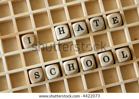 """Wooden dice with the message """"I hate school"""" - stock photo"""