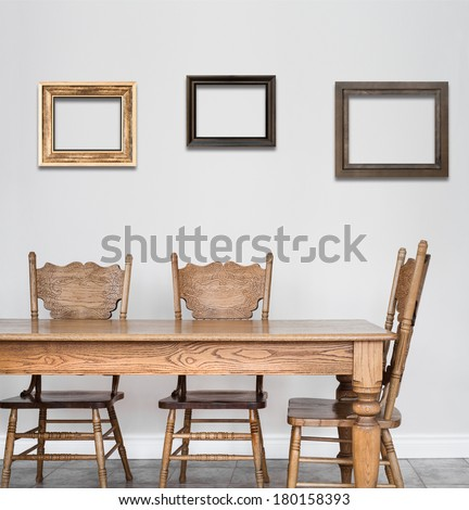 wooden dining room table and chair details and blank frames for your