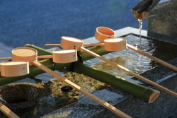 Wooden dipper in Japan Shinto shrine, It's prepare for cleaning before praying