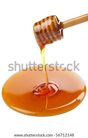 wooden dipper with honey isolated - stock photo