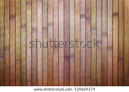 Wooden dirty background of purple bamboo boards