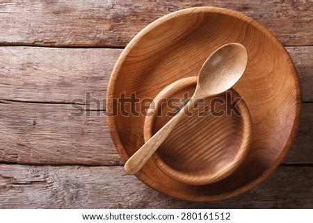 Wooden dish and spoon in a rustic style. horizontal view from above