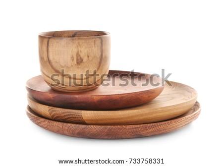 Wooden dishware on white background #733758331