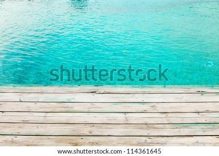 wooden dock and turquoise pool