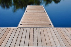 Wooden dock in a lake in a sunny day