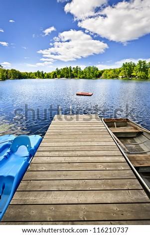 Wooden dock on beautiful summer lake in Ontario Canada #116210737