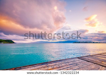 Wooden dock, turquoise sea, pastel clouds and wooden pier at sundown in Akyarlar, Bodrum, Turkey. Beautiful sunset seascape. #1342322234