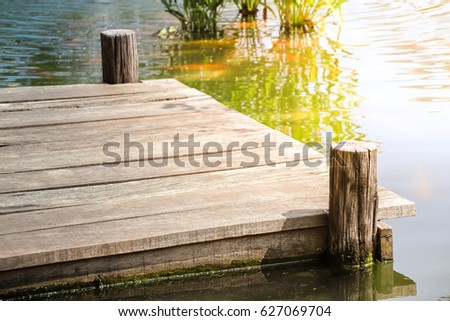 Wooden dock with sunlight on the lake