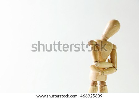 Wooden doll posing trouble on white background #466925609