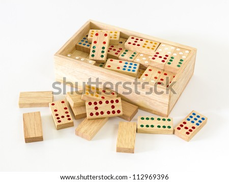 Wooden Domino in wooden box against the white background