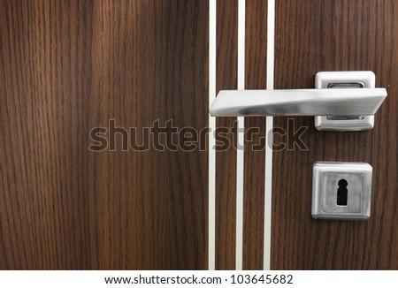 Wooden door and a knob close-up
