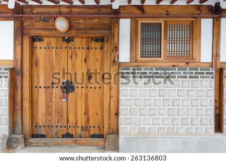 Wooden door korean house style at Bukchon historic district in Seoul, South Korea