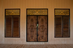 wooden door of a traditional Malay house with wood carving, in the daytime photo, Tanjungpinang, Riau Islands, Indonesia