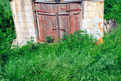 Wooden door of old cellar . Wine store from ancient . Abandoned antique construction