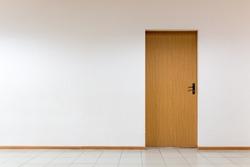 Wooden door on a clean wall indoors