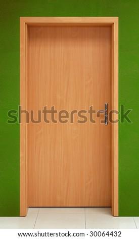 Wooden door on green wall background