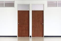 wooden door on  white   walls.