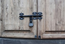 Wooden Door Secured By Padlock Hasp And Staple.