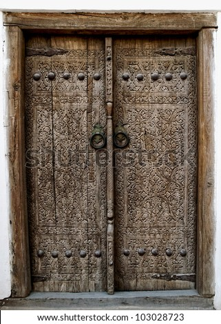 Wooden door with ancient floral patten. Wood carving technic.
