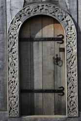wooden door with artful wood carving ornaments of a viking church
