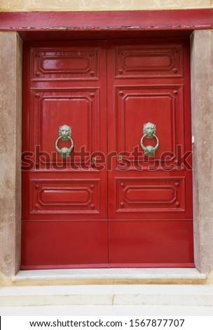 Wooden door with door knockers, Mdina, Malta