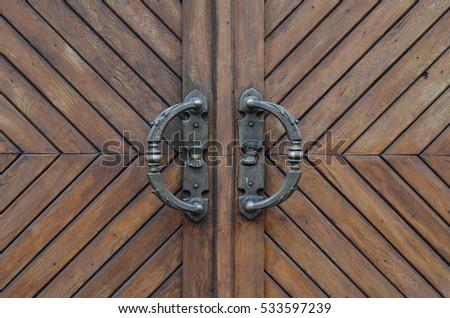 wooden door with iron handles