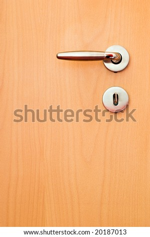wooden door with metal handle